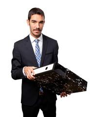 Young businessman saving files