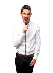 Angry businessman shouting with a microphone