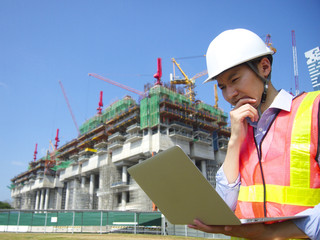 Construction worker using laptop