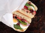 Tuna nicoise sandwich, also known as pan bagnat - 78965928