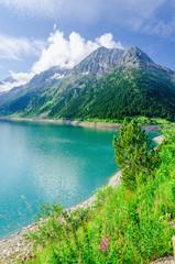 Azure mountain lake and high peaks of the Alps, Austria
