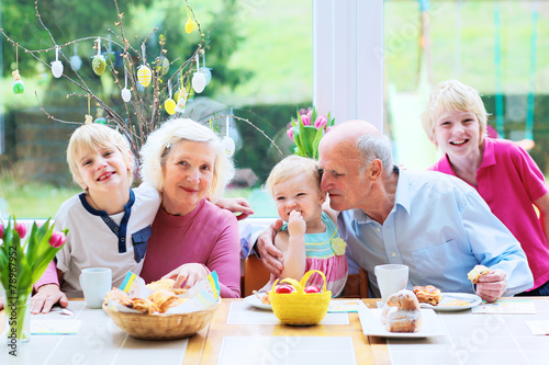Grandparents with grandchildren enjoying Easter breakfast - 78967952