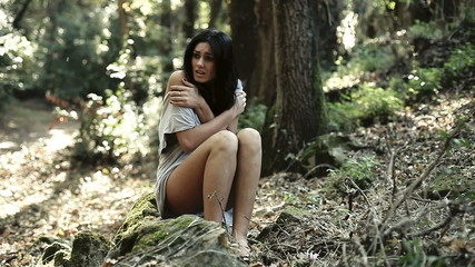 beautiful scared woman in the woods horror movie