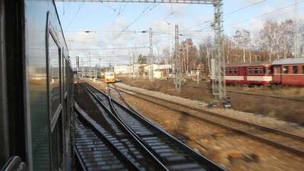 View from train window on electrified tracks. Czech Republic