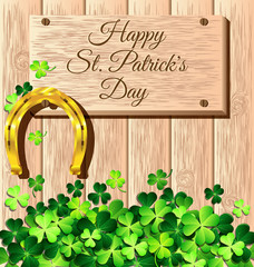St. Patrick's Day frame with gold horseshoe on wooden