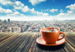 Cup of coffee on city background