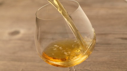 Pouring brandy or whiskey into glass