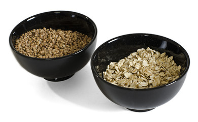 two black bowls with grain
