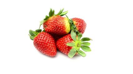 Strawberries rotating on white background
