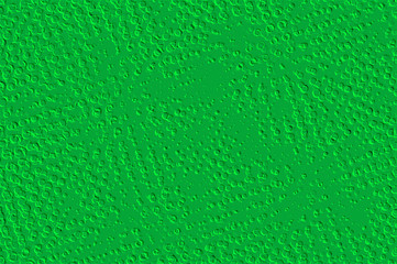 Abstract of random spots in relief in green