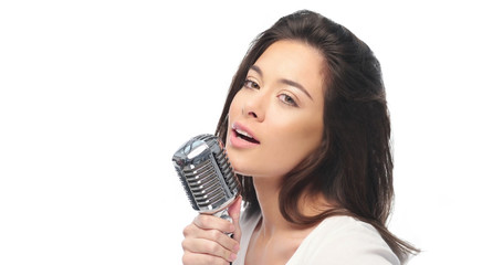 Preety woman singing into a microphone