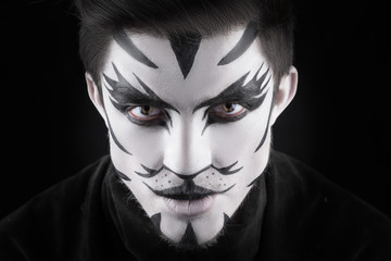 man in make-up, looks like a cat.