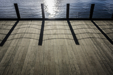 Wooden Decking with Chain Link Shadow