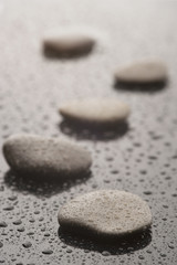 Spa massage stones with water drops, close up