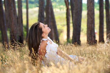 Young woman smiling in a countryside meadow
