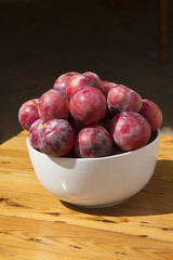 African sweet plums in a white bowl