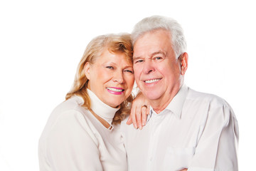 Close up of smiling senior couple in love. Isolated over white
