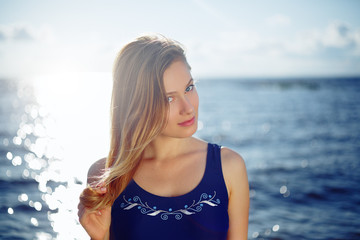 Close op of young woman posing on the beach