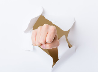 Punch break through the paper wall