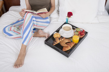 reading and breakfast on bed
