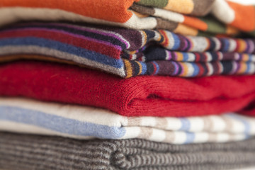Pile of cashmere products on a counter of shop