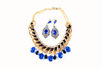Beautiful blue earrings with necklace isolated on white