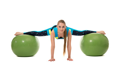 Amazing girl stretched out on two fitness balls