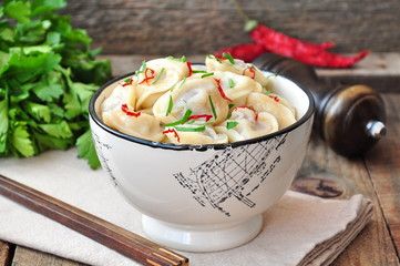 Dumplings and parsley - russian pelmeni - italian ravioli