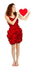 Beautiful young woman in dress made of flower petals isolated