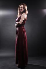 Fashion model in long dress Elegant woman