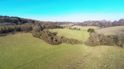 Aerial footage of a slow descent into a grassy valley
