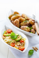 Cabbage salad with avocado and oven potatoes
