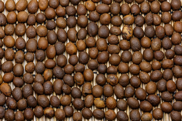 Macro of roasted coffee beans. Beans lay upside down.