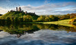 Lake and hill with castle ruin landscape