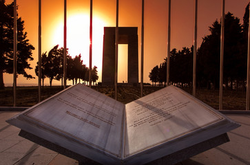 Canakkale Martyrs Memorial at sunset behing a marble book