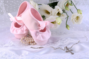 Baby shoe, flowers and cross for Christening