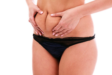 Woman pinches fat on her belly