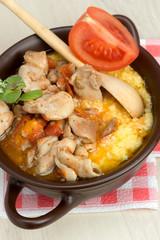 polenta - corn porridge with stewed chicken in oil