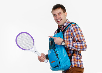 A man with a racket against mosquitoes