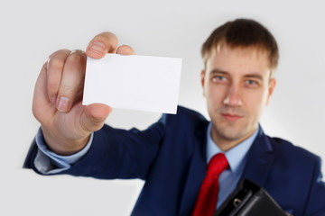A man with a business card and portfolio