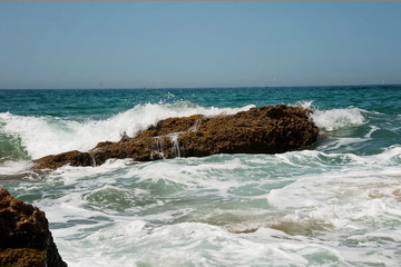 stones waves in the ocean