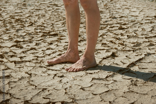 feet on the cracked dry ground - 78988939