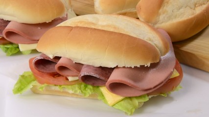 A submarine sandwich with ingredients