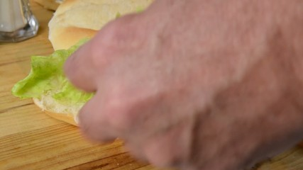 Making a hogie sandwich with cold cuts