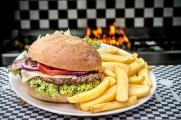 American hamburger with French fries in flames