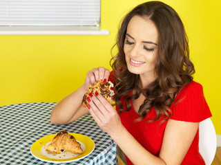 Young Woman Eating a Chocolate Croissant