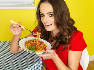 Young Woman Eating Spaghetti Bolognese