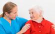 Leinwanddruck Bild Elderly woman and young doctor