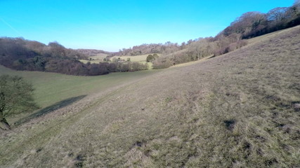 Aerial footage moving along a green valley