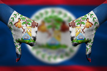 failure of Belize - hands gesturing thumbs down in front of flag